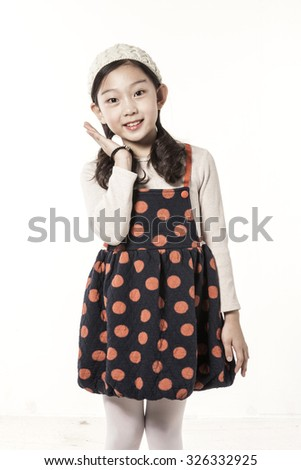 A asian(japanese, chinese, korean) pretty girl(kid, children) portrait with smile in the winter, christmas isolated white at the studio. - stock photo