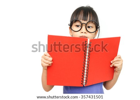 A asian pretty girl hold a book and reading