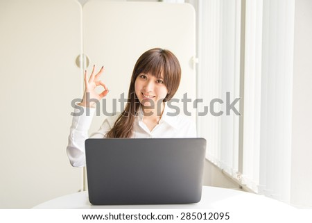 A asian woman with laptop