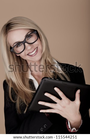 A attractive blond businesswoman holding a black tablet computer. Blond businesswoman.
