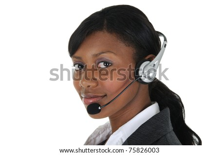 A attractive business woman wearing a headset, isolated on a solid white background. - stock photo