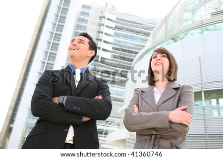 A attractive man and woman business team at their company building