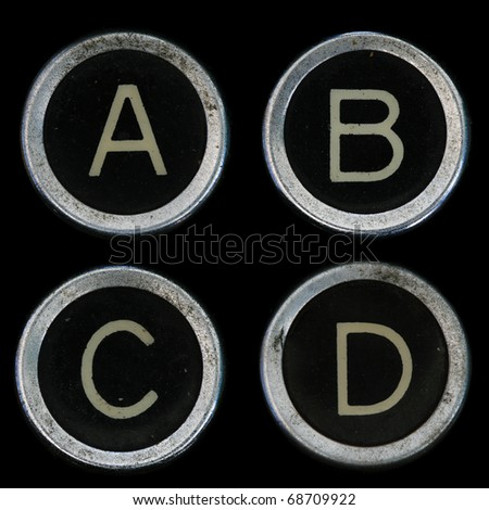 A B C D keys from old typewriter on black background - stock photo