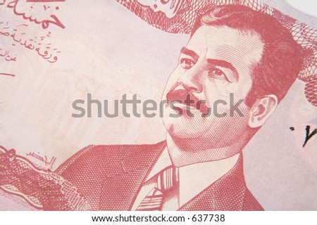 A Ba'athist era 5 dinar Iraqi banknote, showing the image of deposed leader Saddam Hussain - stock photo