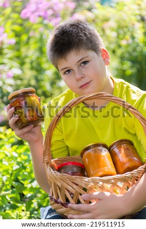 A bA boy and home canned vegetables in natureoy and home canned vegetables in nature