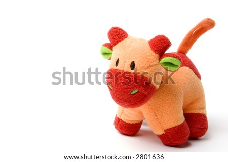 A babies orange soft cow, great for chewing - stock photo