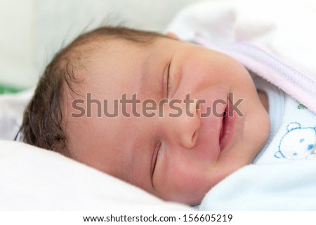 A Baby Boy with Smily Face During Sleep - stock photo
