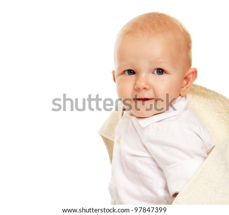 A baby covered with a towel, isolated on white
