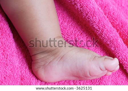 a baby foot a over color pink background