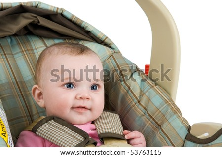 A baby girl in a carseat on a white background.