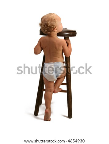 A baby girl learning to sit up on a high long  chair - stock photo