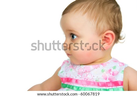 A baby girl looking at blank white copy space