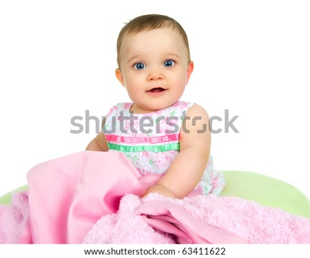 A baby girl playing with a blanket on a white background