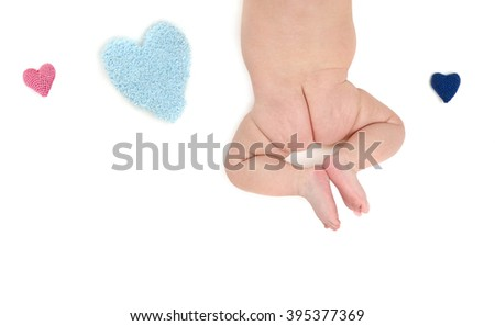 a baby's bum with a knitting heart isolated on a white