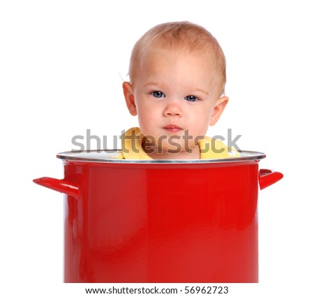 A baby sitting in a red cooking pot. - stock photo