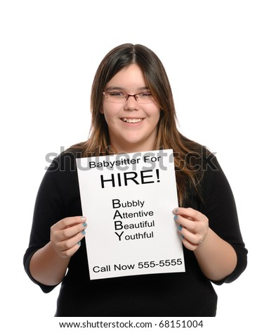 A babysitter holding a paper flyer advertising her skills as a babysitter, isolated against a white background. - stock photo