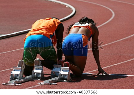 A back view from a couple ready to run, the man is the guide for a blind female runner. - stock photo
