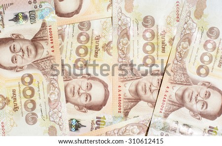 A background and texture with new one thousand banknotes of Thai currency,money - stock photo