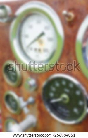 A background blur of a set of meters and guages from an antique fire truck - stock photo