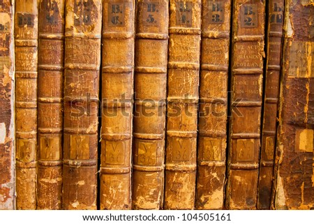 A background collection of rare volumes of Scottish Parliamentary Acts dating around 1424 through 1651. Distressed condition.