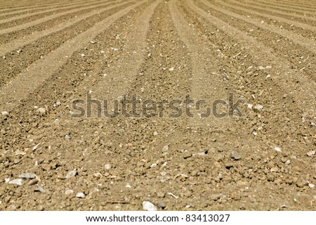 A background image of a plowed field