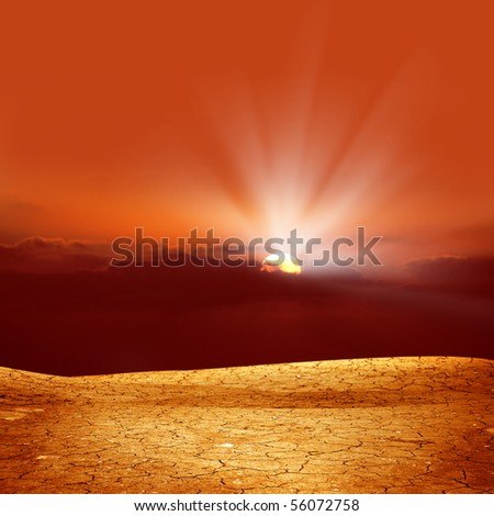 A background image of dried and cracked soil - stock photo