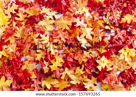 a background, made of a lot of Autumn leaves - stock photo