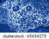 a background of a closeup of soap foam bubbles - stock photo