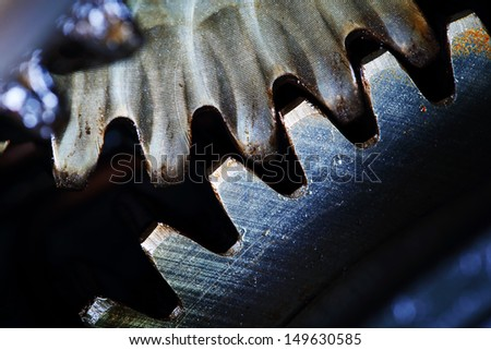 A background of a detailed view of gears from a machine. - stock photo