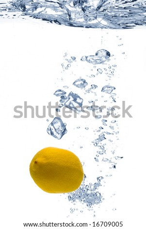 A background of bubbles forming in blue water after ice cubes and lemon are dropped into it. - stock photo