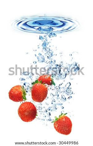 A background of bubbles forming in water after strawberries are dropped into it. - stock photo