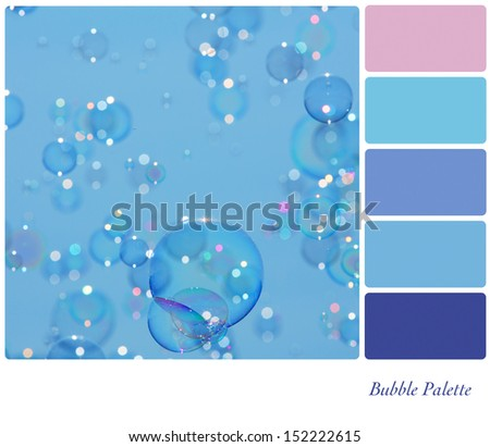 A background of delicate soap bubbles over a blue sky, in a colour palette with complimentary colour swatches - stock photo