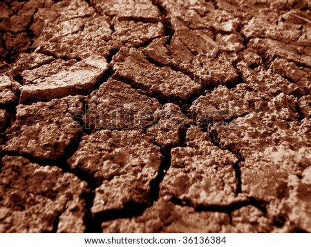 A background of dry red earth during famine.