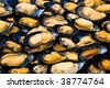 A background of fresh mussels for sale at a French fish market - stock photo