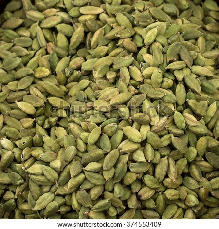 A background of green cardamom pods. - stock photo