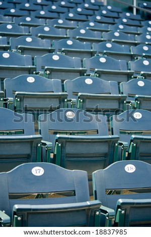 A background of green empty stadium seating