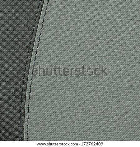 A background of grey stitched material