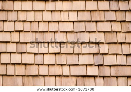 A background of newly installed cedar shingles. - stock photo