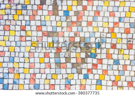 A background of old broken colourful tiles