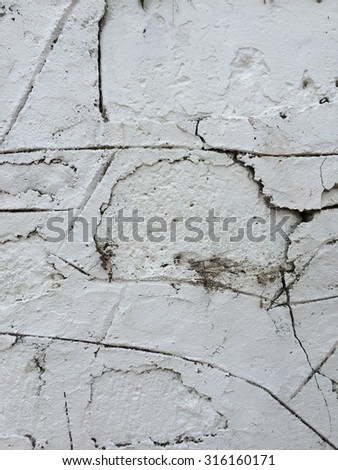 A background of old white stone wall