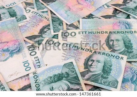 A background of scattered Swedish, 100 Kroner currency notes. - stock photo