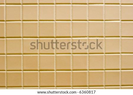 A background of sidelit brown ceramic tile - stock photo