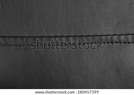 A background of the black stitched leather.