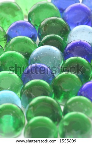 A background of toy marbles created using recycled glass bottles. - stock photo