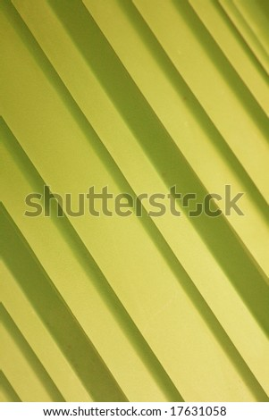 A background of yellow diagonal stripes.