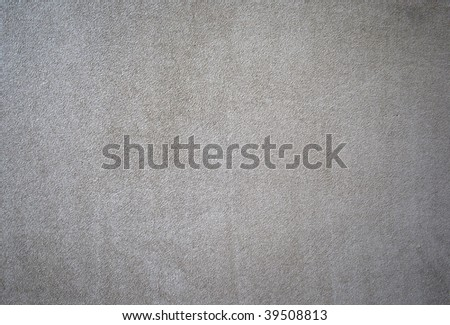 A background or texture of a beige colored suede swatch - stock photo