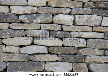 A background texture of a typically English dry-stone wall. - stock photo