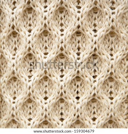 A background texture of knitted Aran wool - stock photo
