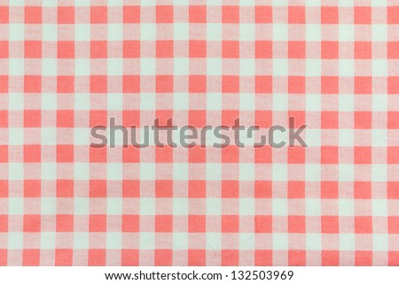 a background texture of Orange plaid fabric - stock photo