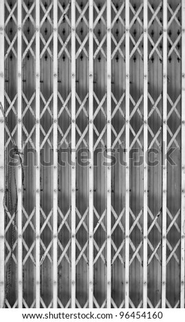 A background textured image of shutters on a shop or industrial building. - stock photo